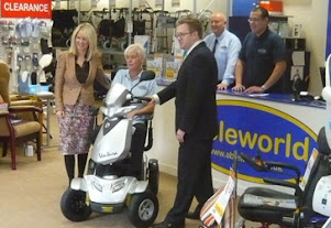 Andy Rees pictured with store staff and MP Esther McVey