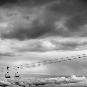 Above the clouds by Emil Zaman - Black & White Objects & Still Life ( rain, chairlift, clodus, black and white, two )