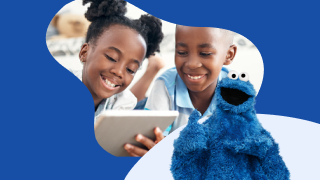 image of boy and girl looking at tablet together