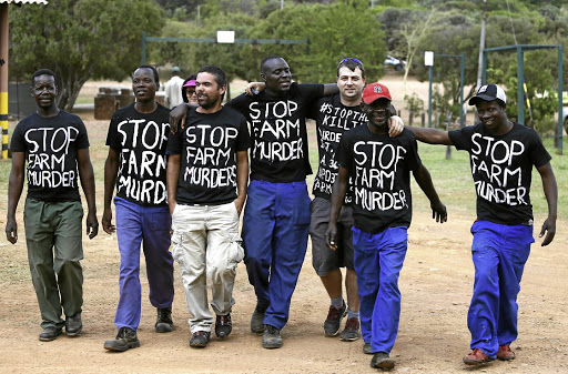 UNITED THEY STAND A handful of black people joined families of murdered farmers during their gathering at the Voortrekker Monument in Pretoria in support of #BlackMondayPicture: Phill Magakoe