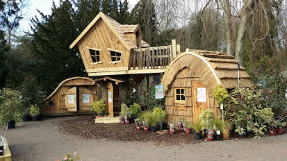 Bespoke wooden playhouses enchanted creations playhouses for Cheap tree house plans