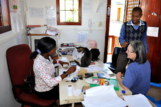 Photo: In the Office with the financial staff, Dr. E and cat assistant