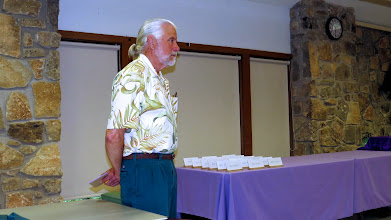 Photo: David Kraemer waits for the blue-ribbon entries which he will move to the Table of Consideration.