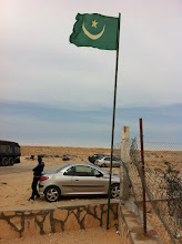 Photo: Mauritania at last, one can see where the asfalt road is starting again