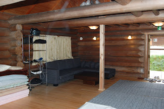 Photo: 1階ホール ソファー、テーブル設置 布団を敷く事で6名宿泊可。