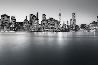 Photo: The New York City Skyline - Skyscrapers of the Financial District  In the winter, there is a clarity and edge that is carried on the frigid fingers of icy air and crystallized exhales.  —- I have been really getting into long exposures. There is something incredibly zen about the experience of setting up, and taking long exposures. The waiting is interesting. It forces a pause in the process. You start to be hyper-aware of the movement of clouds and light transitions. In the winter especially, it's a commitment. The minute or so of waiting seems to encompass an eternity of thought(s). —-  This is a 30 second exposure of the lower Manhattan skyline featuring the skyscrapers of the Financial District and Pier 17 taken with the Sony a99. The Freedom Tower (also known as 1 WTC or One World Trade Center), New York by Gehry, the Woolworth Building and the spire of the Municipal Building can all be seen here.    You can view this post along with all relevant links at my photography blog if you wish here:  http://nythroughthelens.com/post/43698597924/the-new-york-city-skyline-with-financial-district    Tags: #photography  #nyc  #newyorkcity  #manhattan  #nycphotography  #newyorkcityphotography  #blackandwhitephotography  #blackandwhitenyc  #longexposure  #longexposurethursday  #sony  #sonyphotographers  #sonya99  #nycskyline  #newyorkcityskyline  #skyscrapers