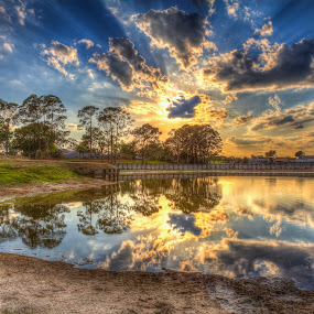 Reflection at 7:15pm by George Bloise - Landscapes Sunsets & Sunrises ( clouds, blue, florida, sunset, pwcreflections, lake )