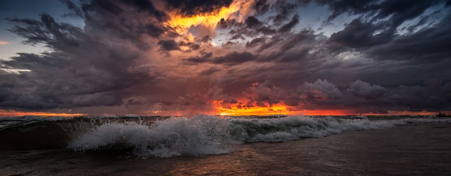 Stormy Sunset by Calvin Morgan - Landscapes Sunsets & Sunrises ( nikon d700, tokina 17-35mm, lake michigan, waves, sunset, lake, storm clouds )