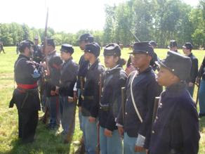 Photo: Sgt Major  performs safety inspection of 14th Reg. USCLA troopers on line with 6th Reg. USCT cadets