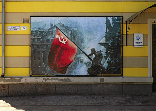 A bloody past: A victory mural of the Second World War. The Soviet Union regained the area in 1944 after driving out the Axis forces. Russia still supports the country. Picture: TRISTEN TAYLOR