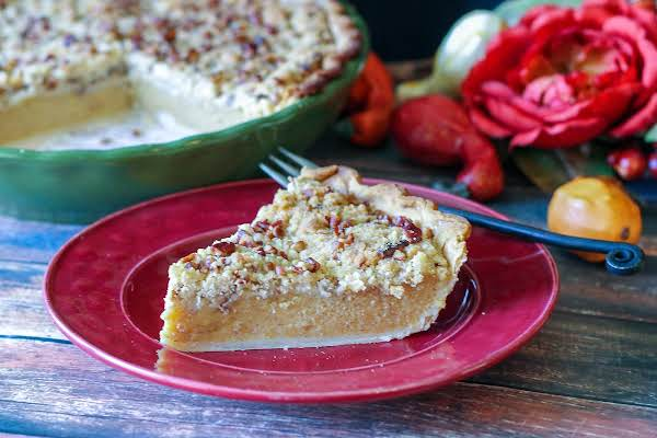 A Slice Of Acorn Squash Streusel Pie On A Red Plate.