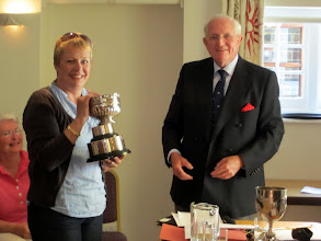 Photo: Catherine Radford receiving the Ladies Rose Bowl for leading the team for the 2010 Bosham Ball