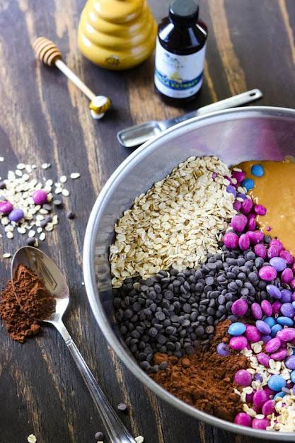 bowl full of ingredients for monster cookies