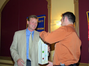 Photo: Jonathan Westeinde accepting gift from Robert Lefebvre (2007-2008 OVC President)