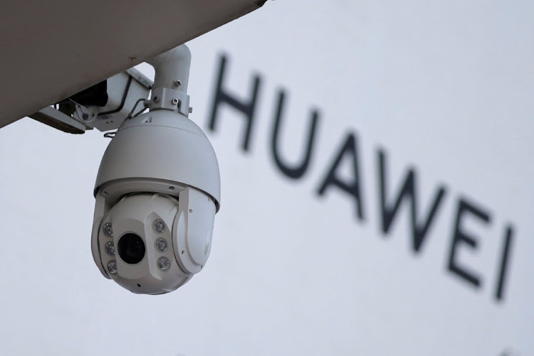 A surveillance camera is seen next to a sign of Huawei outside a shopping mall in Beijing, China, on January 29, 2019. File photo: REUTERS/JASON LEE