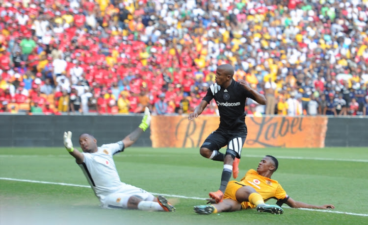 Luvuyo Memela of Orlando Pirates scoring his goal past Itumeleng Khune and Siyabonga Ngezana of Kaizer Chiefs during the Absa Premiership match between Orlando Pirates and Kaizer Chiefs at FNB Stadium on March 03, 2018 in Johannesburg, South Africa.