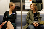Former Sex and the City star and candidate for governor of New York Cynthia Nixon (left) speaks to a fellow passenger on the 4 train in Brooklyn. (File photo)