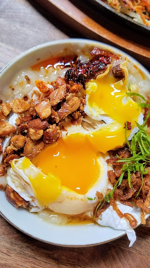 Expatriate Brunch, Expatriate Congee with savory rice porridge, dashi, fried garlic & shallots, chinese celery, poached duck egg, fish sauce ponzu