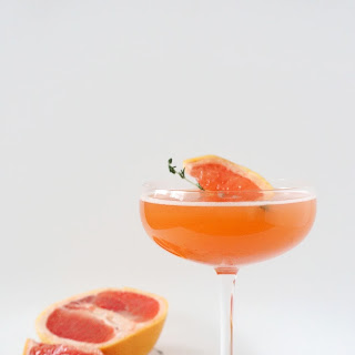 Whimsical Valentine's Day Cocktail with grapefruit juice and cardamom bitters.