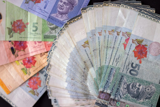 Ringgit stunned by lockdown, record-high Covid-19 cases