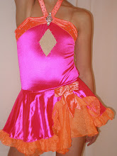"""Photo: Custom Made! To buy (CSD-More/Girls) email me at Pam@Act2DanceCostumes.com  $95.00 Qty (3) sz: (1)Med Child 8/10, (2)Large Child 10/12.  Custom design pink w/orange accents.  This costume has 1.5 gross swarovski crystal ab rhinestones.  The beautiful rhinestone  broach adds a nice touch to the front while the """"V"""" cut back adds style.  Med child costume comes with gloves and a hairbow.   I have a Boys costume name """"More"""" that pairs with this Girls """"More"""" costume.  $10 US shipping.  Paypal/Credit accepted.  Tracking included.  7 day returns, same condition.  Thanks! CSD, CSD030, LH"""