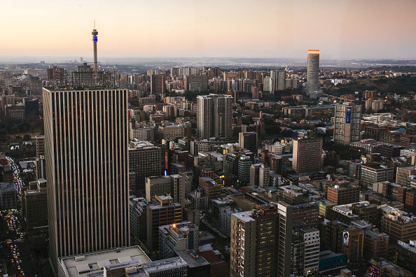 Commercial buildings and office property stand on the city skyline in Johannesburg. Africa's rapid urbanisation is a huge opportunity for national governments.