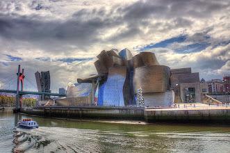 Photo: Guggenheim Museum alongside the Nervion River in Bilbao, Spain.
