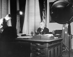 Photo: Ambassador O. Max Gardner sitting behind desk. Taken by Marie Hansen in 1947.