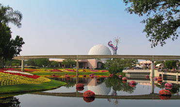 Photo: Epcot's Flower & Garden Festival provides photographers of all levels with opportunities to take photos with amazing color and vibrancy. This photo was taken on a day trip to the parks where we got to see and enjoy the flowers all day. This is an older photo and doesn't have all the pluses of my newer equipment. I've tweaked it slightly, adding some color to the sky, increasing the colors and contrast, and finally a bit off  cropping to remove some off the extra stuff. Now, I would have probably waited to include a monorail in the shot, but back then I wasn't quite as savvy.