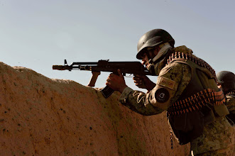 Photo: A policemen with 2nd Battalion, 3rd Afghan National Civil Order Police Brigade, provides security over-watch during a joint Afghan-Coalition patrol of Kandahar Province's Zhari District, Oct. 19, 2010.  Policemen with 2nd Bn. are partnered with members of Special Operations Task Force - South. (U.S. Army photo by Sgt. Ben Watson / Special Operations Task Force - South).
