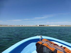 Photo: Approaching our camp on the large bay beach.