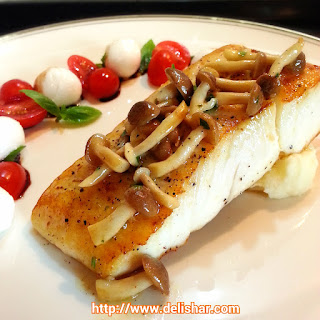 Pan Seared Halibut with Yuzu Mushroom Butter Sauce and Pomme Puree.