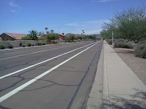 Photo: Knox Rd, Phoenix (Pic4) where may a bicyclist ride in order to comply with 28-815A, as far right as practicable? Note that this is a designated Bike lane (between the two white stripes).