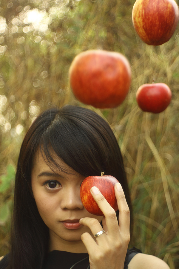 Flying Apple by Raymond Omar - People Portraits of Women