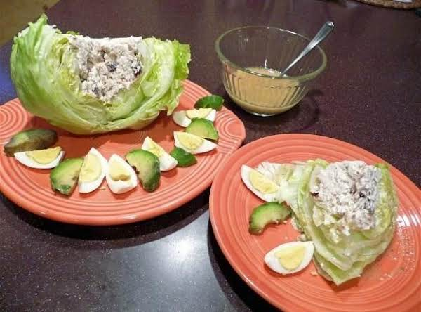 Lettuce Wedges Stuffed With Chicken Cobb-caesar Filling With Raisins.