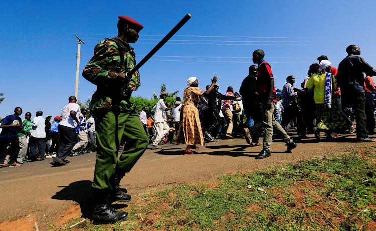 A riot policeman disperses residents chanting slogans on the road during the visit by former US president Barack Obama to his ancestral Nyangoma Kogelo village in Siaya county, Kenya.