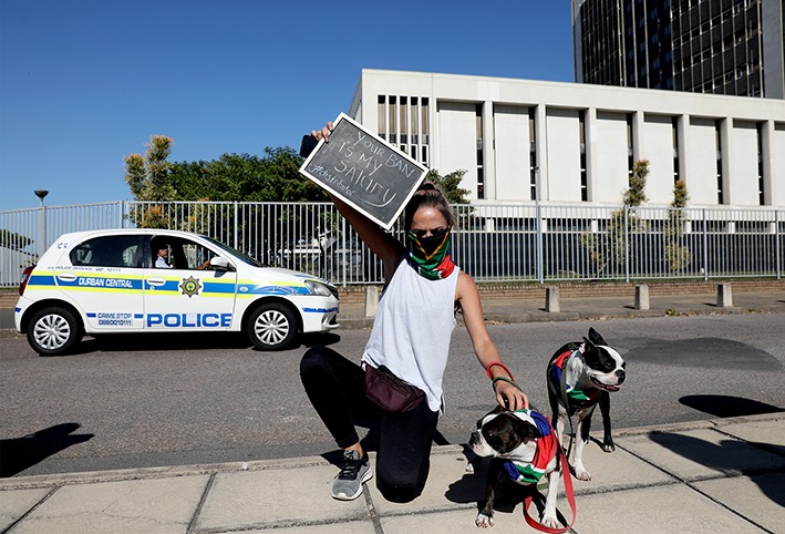 Charlene Wannenburg,33, outside the Durban magistrate's court during protest action against government's continued ban on the sale of tobacco and related products.