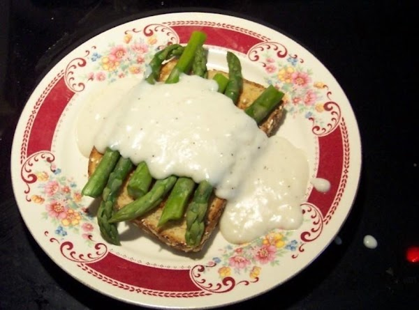 Put toast on a plate,  cover toast with the steamed asparagus. Ladle on the hot...