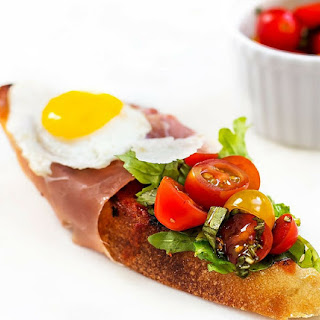 Bruschetta with Prosciutto, Tomato Basil and Quail Eggs