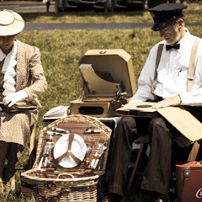 Sunday in the Park by Eugene Linzy - People Couples ( cooler, park, woman, phonograph, couple, 1920s, records, picnic hamper, man, picnic )