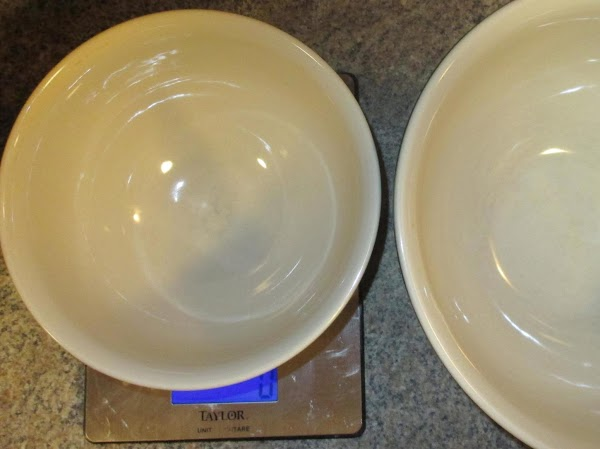Place a small bowl on a digital kitchen scale and tare to zero. ...