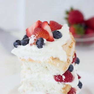 Angel Food Cake with Coconut Whipped Cream and Berries.