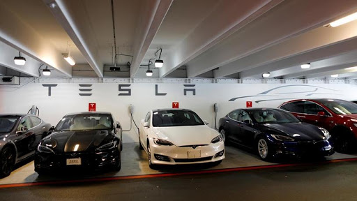 The price reduction of Tesla vehicles sent shares of the electric vehicle maker down nearly 7% on worries of future profitability.
