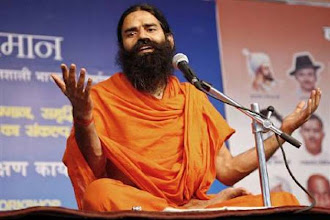 Photo: Ramdev gives a clean chit to Narendra Modi on corruption http://t.in.com/6qys