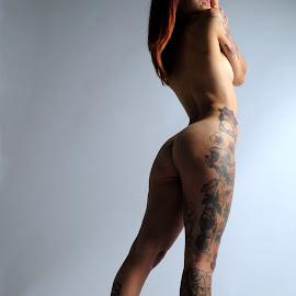 Thigh of Flowers by DJ Cockburn - Nudes & Boudoir Artistic Nude ( studio, art nude, model, auburn, nude, woman, pierced nipple, redhead, tattoo, lucerne, standing )