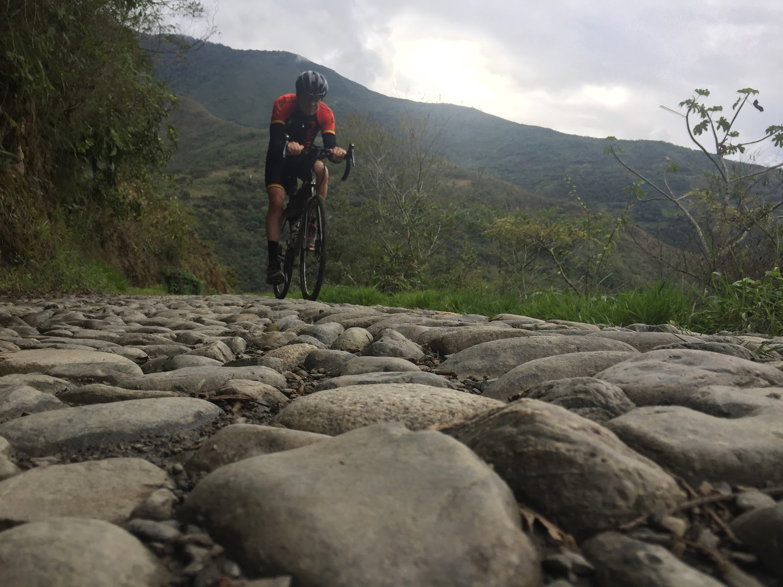 Bicyclist riding over giant cobbles on North Yungas Road