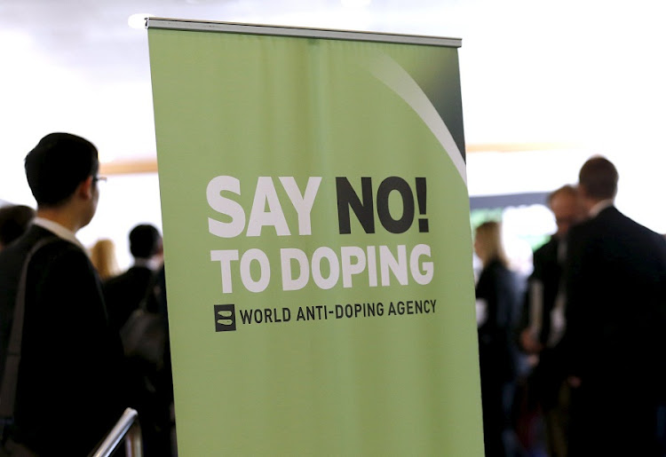 Participants talk before the start of the World Anti-Doping Agency symposium for Anti-Doping Organisations in Lausanne. Picture: REUTERS/DENIS BALIBOUSE