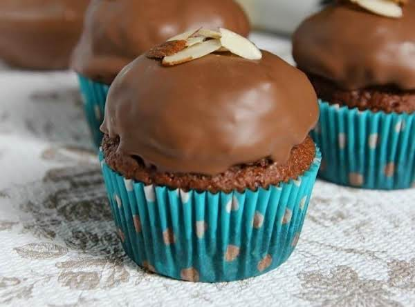 Recipe And Photo From:  Http://www.yourcupofcake.com/2012/07/almond-joy-cupcakes.html