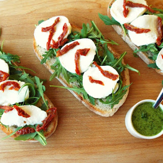 Arugula, Mozzarella, Sun-dried Tomato, and Basil Oil Bruschetta.