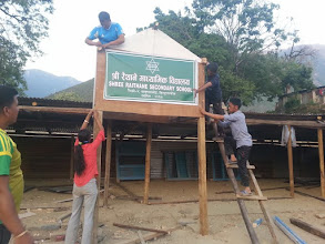 Photo: The board of Shree Raithane Secondary School being put up